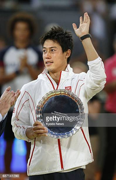 MADRID Spain Japan's Kei Nishikori acknowledges applause from spectators after becoming runnerup at the Madrid Open tennis tournament in Madrid on...