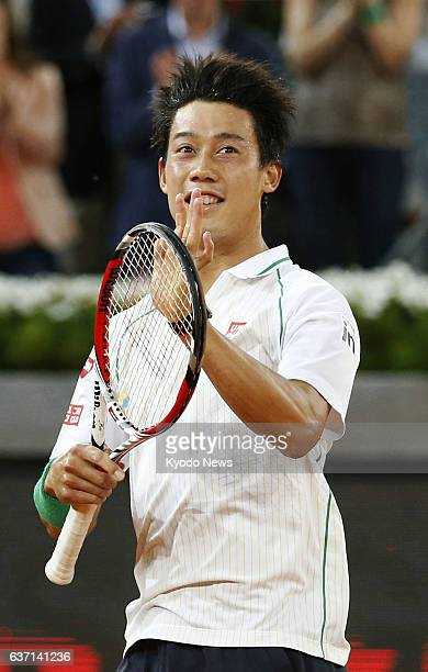 MADRID Spain Japan's Kei Nishikori acknowledges cheers from spectators after beating Spaniard David Ferrer in a semifinal match of the men's singles...