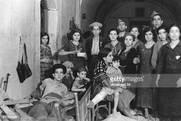 Spain La Mancha Castile Toledo Spanish Civil War Siege of the Alcazar fortress picture taken after the relief by Nationalist troops group of almost...