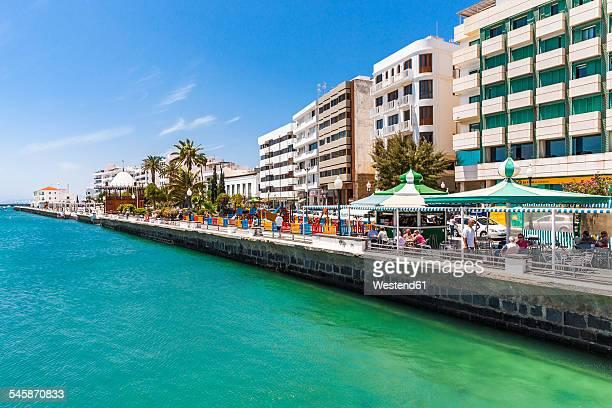 spain, lanzarote, arrecife, waterfront promenade avenida olof palme - arrecife stock photos and pictures
