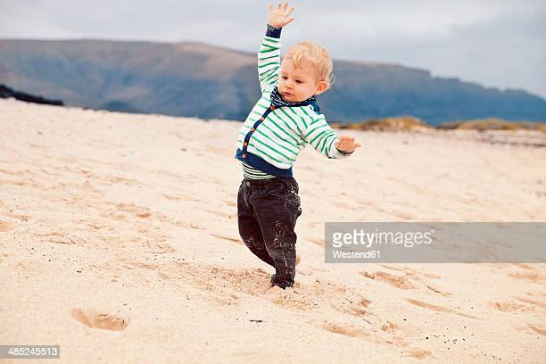 Spain, Lanzarote, Playa Blanca, little boy balancing at the beach