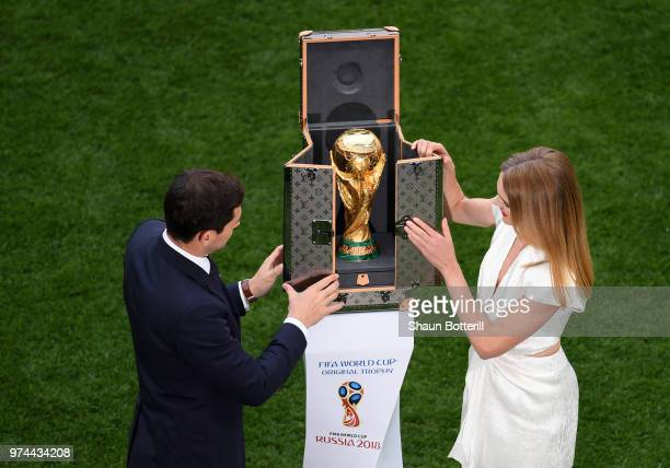 Spain legend Iker Casillas and model Natalia Vodianova show the World Cup trophy prior to the 2018 FIFA World Cup Russia Group A match between Russia...