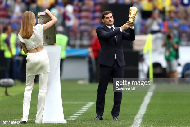 Spain legend Iker Casillas lifts the World Cup trophy in front of model Natalia Vodianova prior to the 2018 FIFA World Cup Russia Group A match...