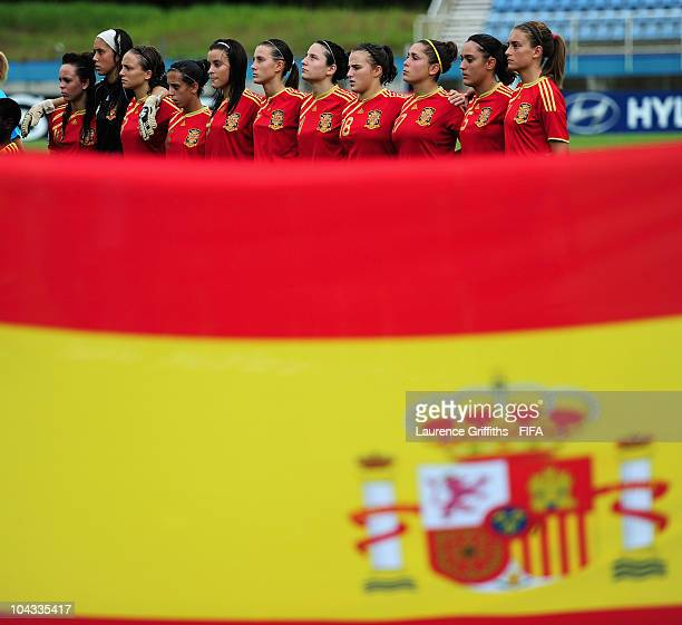 Spain line up for the National Anthem during the FIFA U17 Women's World Cup Semi Final match between South Korea and Spain at the Ato Boldon Stadium...