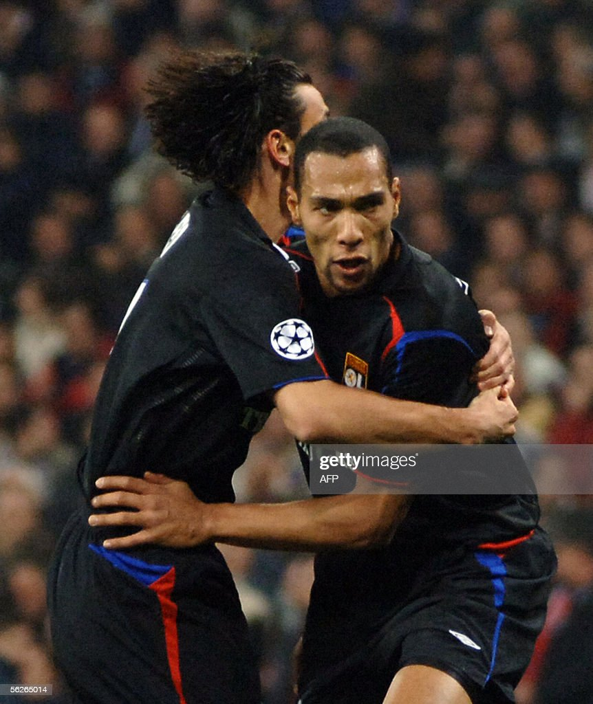 Lyon's John Carew celebrates after scoring against Real Madrid with