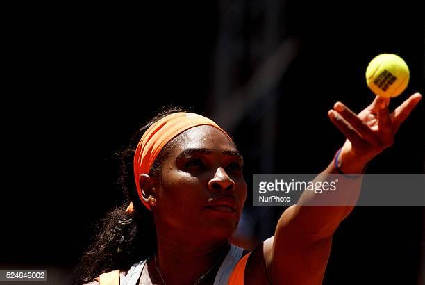American tennis player Serena Williams serves against Spanish tennis player Carla suarez during the Madrid WTA Masters Series Tournament tennis match...