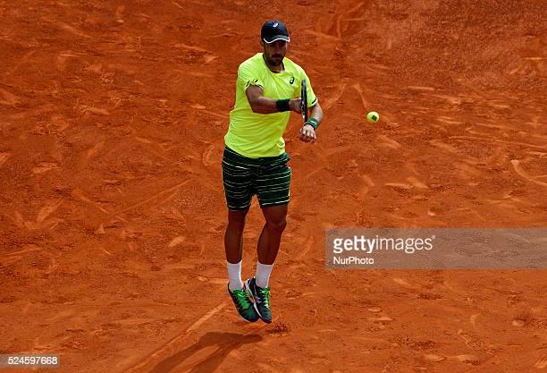 American tennis player Steve Johnson returns the ball to Spanish tennis player Rafael Nadal during the Madrid ATP Masters Series Tournament tennis...