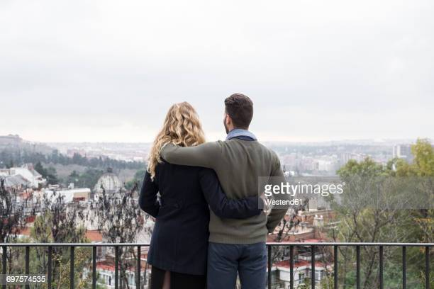 Spain, Madrid, couple looking at the city