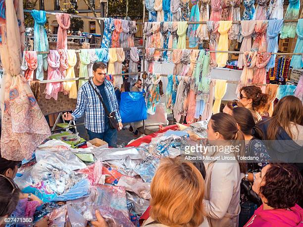 spain, madrid, el rastro flea market - pashminas - el rastro stock pictures, royalty-free photos & images