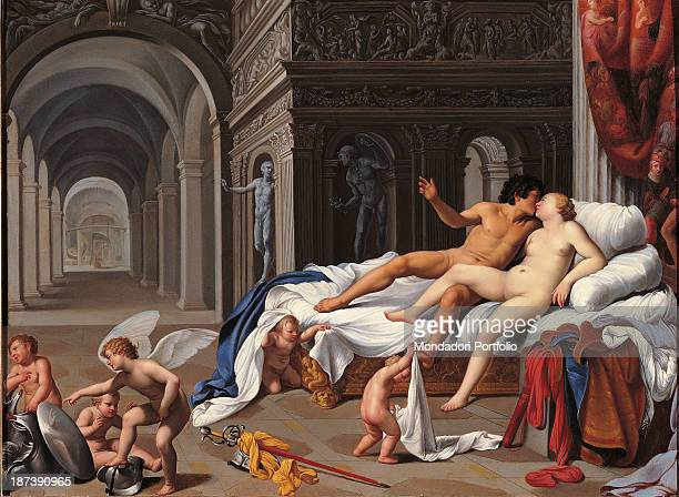 Spain Madrid Museo ThyssenBornemisza All Painting showing Mars and Venus naked on a bed kissing each other Around them playing on the floor are five...