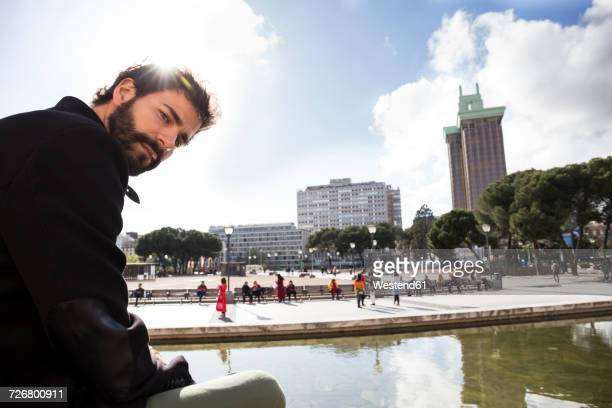 Spain, Madrid, pensive man at backlight