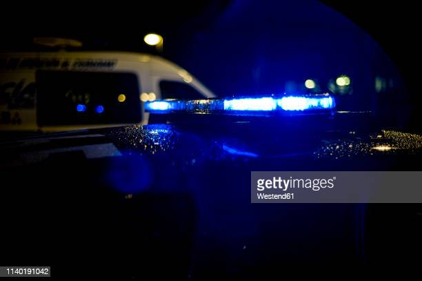 spain, madrid, rain falling on a police car at night - police vehicle lighting stock pictures, royalty-free photos & images