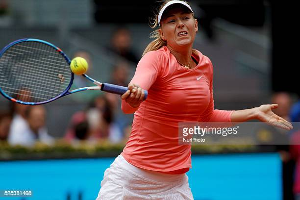 Russian tennis player Mar��a Shar��pova returns the ball to Switzerland tennis player Timea Bacsinszky during the Madrid WTA Masters Series...
