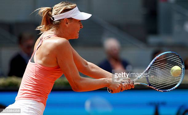 Russian tennis player Mara Sharpova returns the ball to Danish tennis player Caroline Wozniacki during the Madrid WTA Masters Series Tournament...