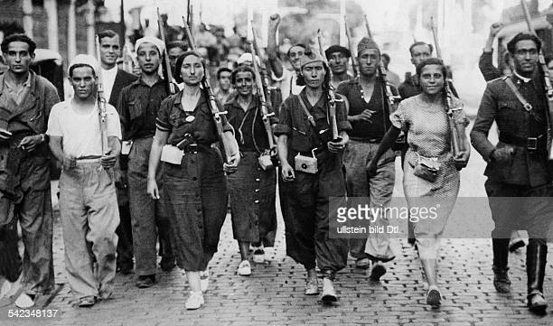 Spain Madrid Spanish Civil War Members of the women's militia of the Popular Front and their comrades marching through the streets of Madrid late...