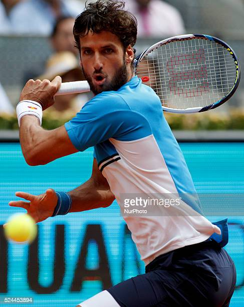 Spanish tennis player Feliciano L��pez returns the ball to German tennis player Benjamin Becker during the Madrid ATP Masters Series Tournament...
