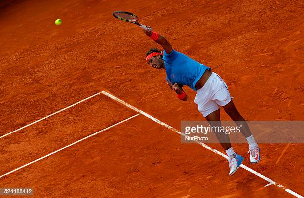 Spanish tennis player Rafael Nadal returns the ball to American tennis player Steve Johnson during the Madrid ATP Masters Series Tournament tennis...