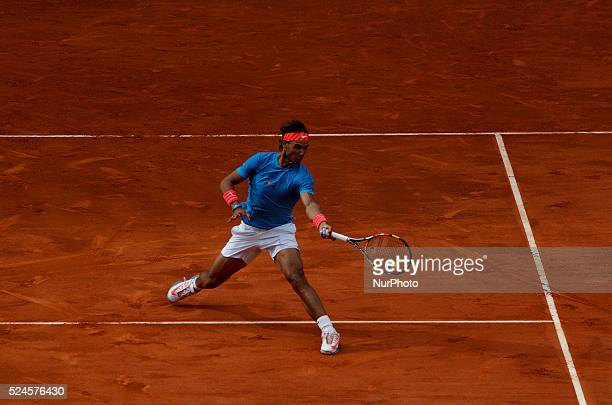 Spanish tennis player Rafael Nadal returns the ball to American tennis player Steve Johnson during the Madrid ATP Masters Series Tournament tennis...
