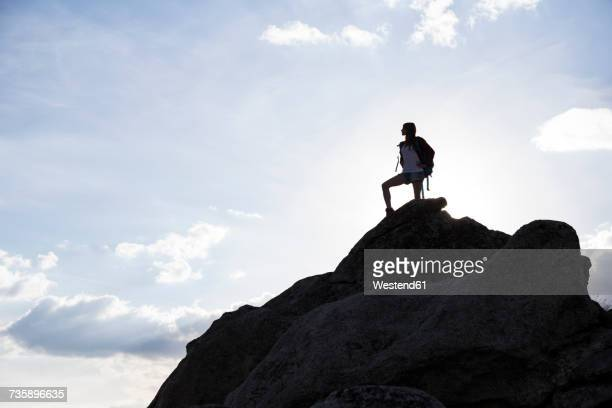 spain, madrid, young woman on a rock observing the landscape - hero and not superhero stock pictures, royalty-free photos & images