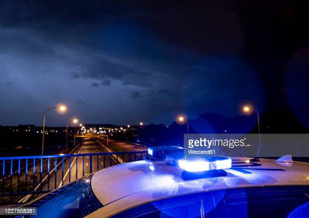 spain, madrid,close-upof police emergency lights glowing during night intervention - police car stock pictures, royalty-free photos & images