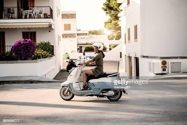 spain, majorca, alcudia, woman on motor scooter - スクーター ストックフォトと画像