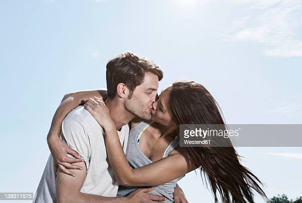 spain, majorca, young couple kissing each other - bacio sulla bocca foto e immagini stock
