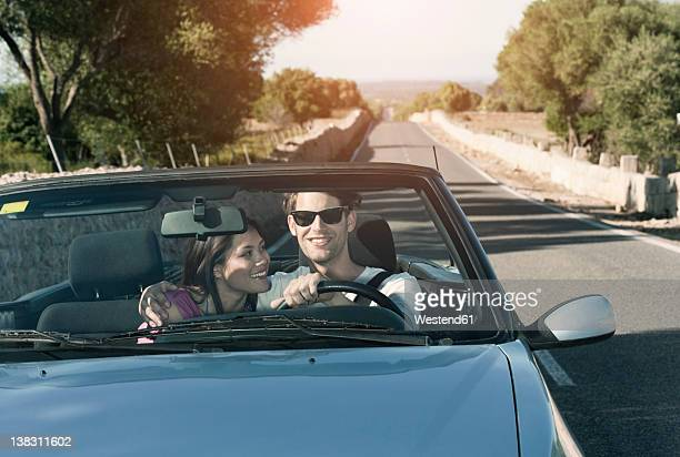 Spain, Majorca, Young couple travelling in cabriolet car