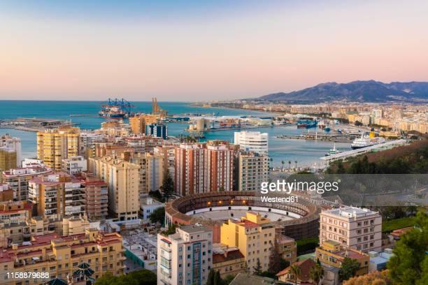 spain, malaga, view over the harbour and la malagueta bullring by sunrise - マラガ県 ストックフォトと画像