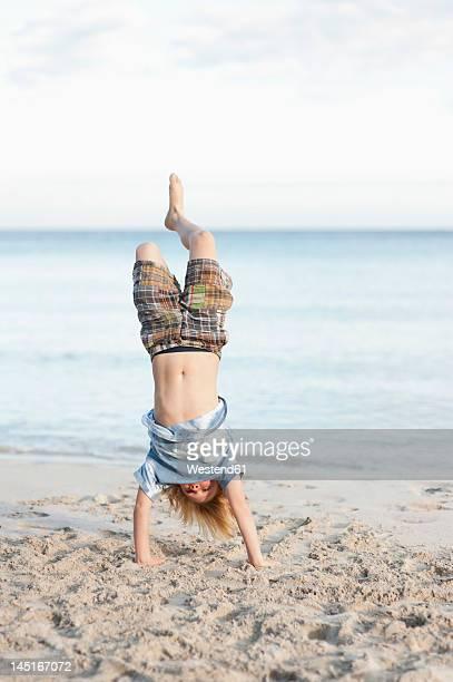 Spain, Mallorca, Boy playing on beach