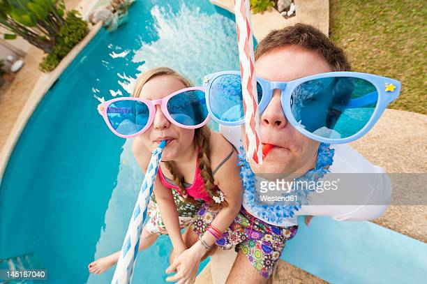 Spain, Mallorca, Couple playing on swimming pool