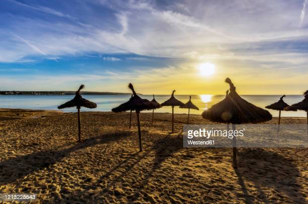 spain, mallorca, el arenal, beach at sunrise - majorca stock pictures, royalty-free photos & images