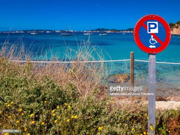 spain, mallorca island, calvia - cala xinxell - disabled sign stock photos and pictures