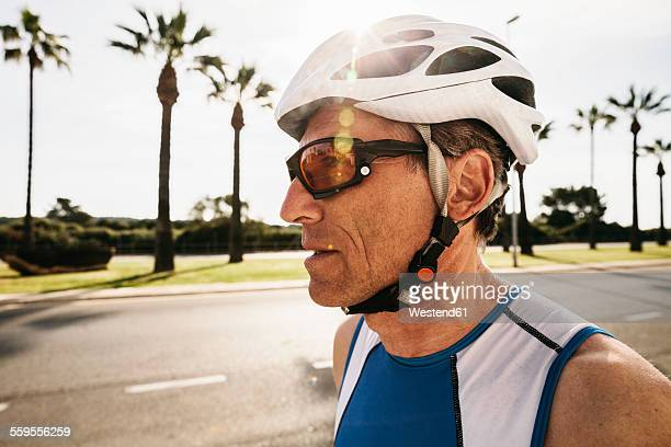 Spain, Mallorca, Sa Coma, portrait of triathlet with cycling helmet