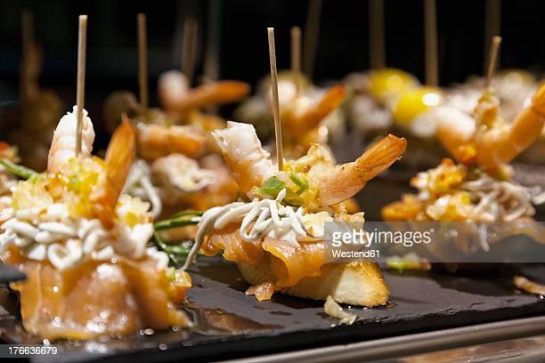 spain, mallorca, tapas with fish in palma de mallorca, close up - tapas stock photos and pictures