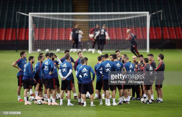 Spain manager Luis Enrique speaks to his players during the training session at the Principality Stadium, Cardiff.