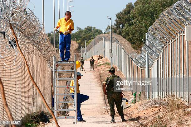 reparation of the border fence in the area Rostrogordo after africans tried to cross the border