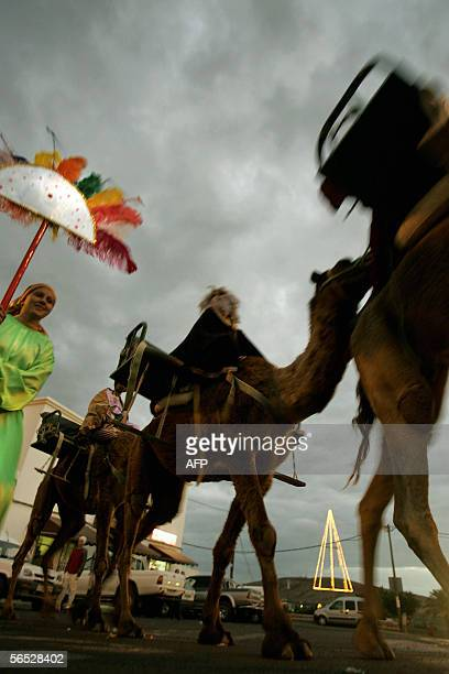Men dressed as the three Kings or wise men Caspar Melchior and Balthazar ride on camels during an Epiphany street parade in Tuineje on the island of...