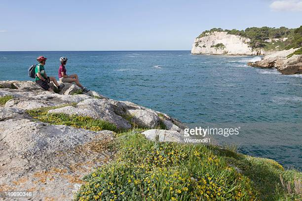 Spain, Menorca, Cavalleria, Man and woman looking at view