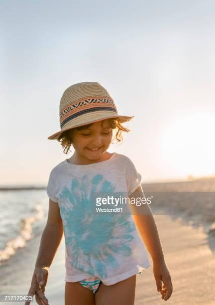 Spain, Menorca, smiling little girl on the beach