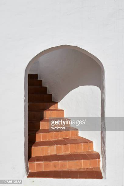 spain, menorca, white wall with arch and staircase behind - arch stock pictures, royalty-free photos & images