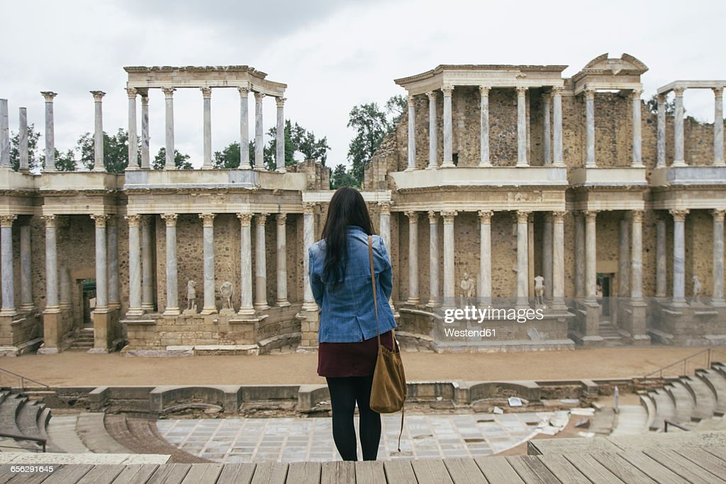 Spain, Merida, back view of woman standing in front of Roman theater : Stock Photo