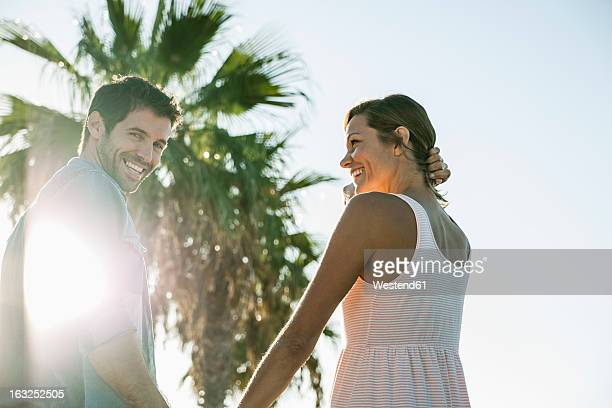 Spain, Mid adult couple smiling