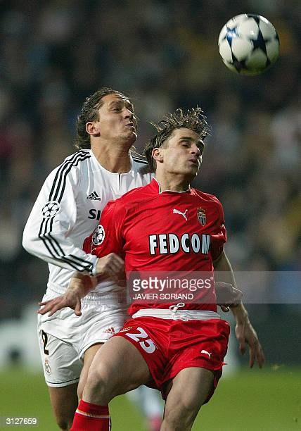 Monaco's French midfielder Jerome Rothen and Real Madrid's Spanish defender Michel Salgado jump for the ball during their Champions League...