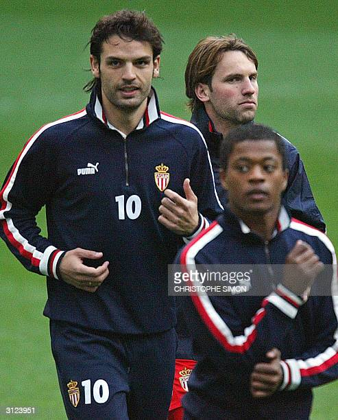 Monaco's Spanish forward Fernando Morientes runs with his teammates during a training session on the eve of their Champions league quarter-final...