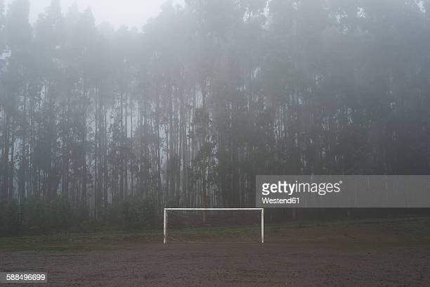 Spain, muddy soccer field in winter
