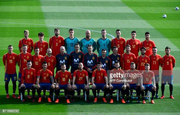 Spain national football players and tehcnical staff pose with their new jerseys at the 'Ciudad del Futbol' in Las Rozas near Madrid on November 8...