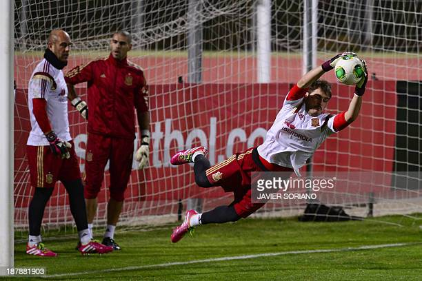 Spain National football players Iker Casillas Victor Valdes and Jose Manuel Reina take part in a training session on November 13 2013 at Sport City...