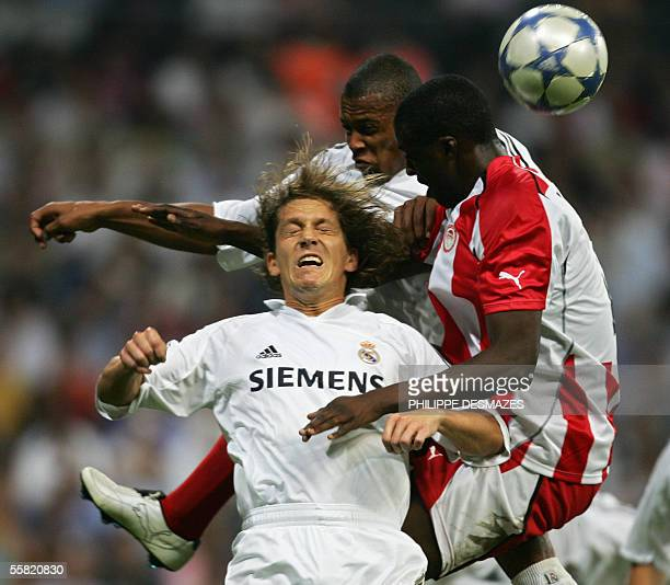 Olympiakos's Yaya Toure jumps for a header with Real Madrid's Michel Salgado and Julio Baptista during their Champions League group F football match...