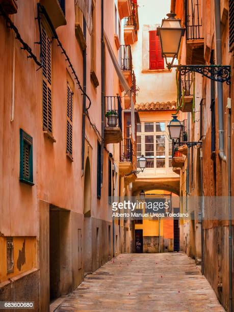 spain, palma de mallorca, small alley - palma majorca stock photos and pictures