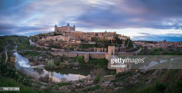 spain, panorama view of toledo in the evening - toledo spain stock pictures, royalty-free photos & images